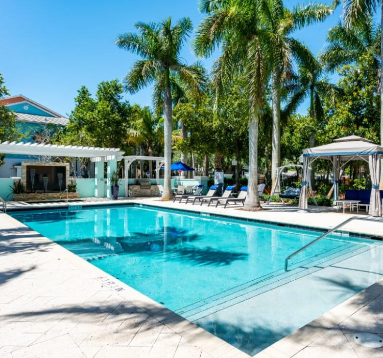 Pool and shaded seating at the barbecue area with gas grills at The Pearl in Ft Lauderdale, Florida