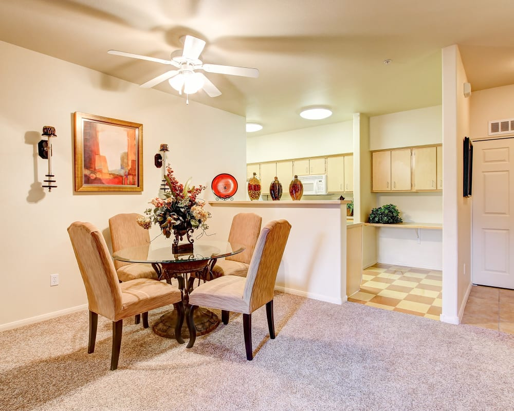 Quaint living room with plush carpeting at Capitol Place Apartments in West Sacramento, California