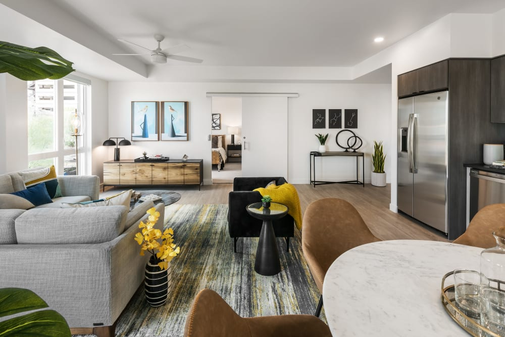 Spacious living area with stainless steel appliances at Hudson on Farmer in Tempe, Arizona