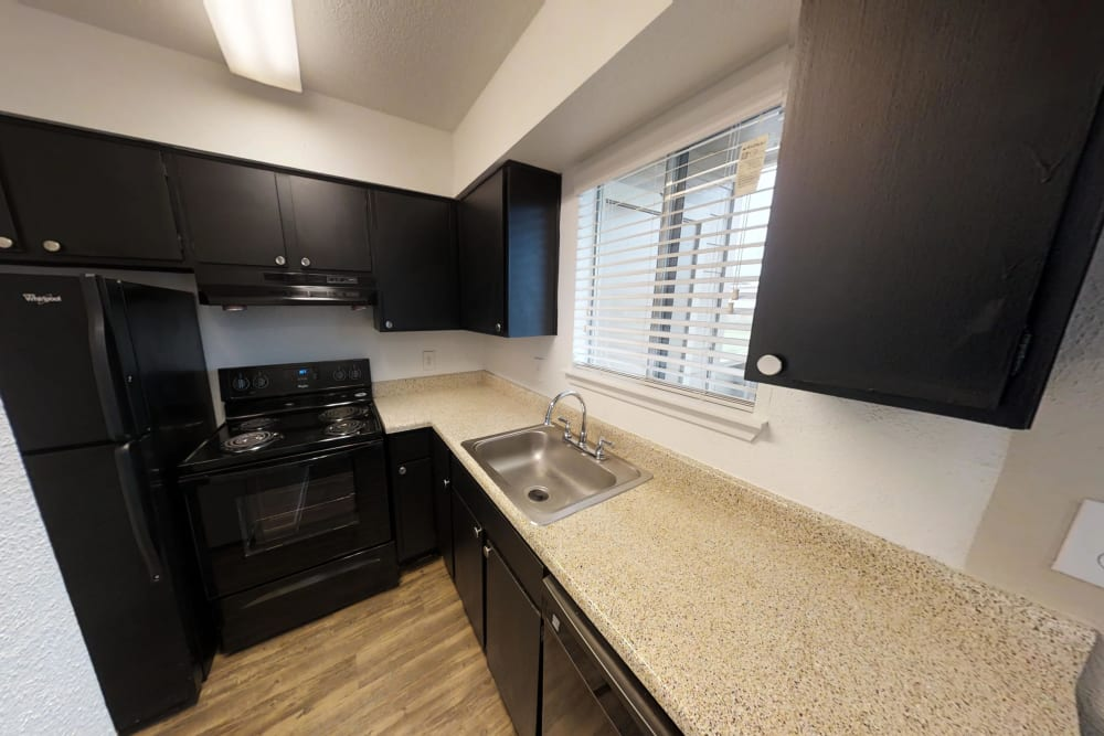 Meadow Park Apartments offers a kitchen in Alvin, Texas