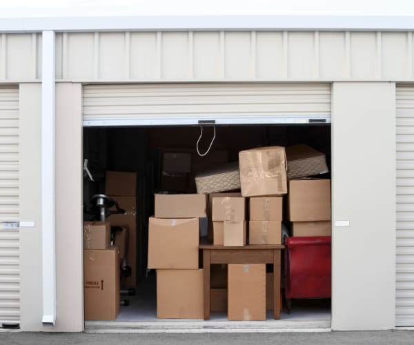 An open storage unit showing stored boxes and furniture at 603 Storage