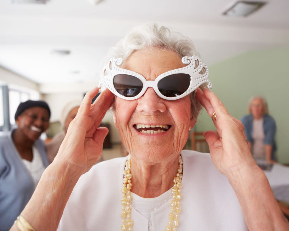 Resident wears fun sunglasses at Landings of Blaine in Blaine, Minnesota.