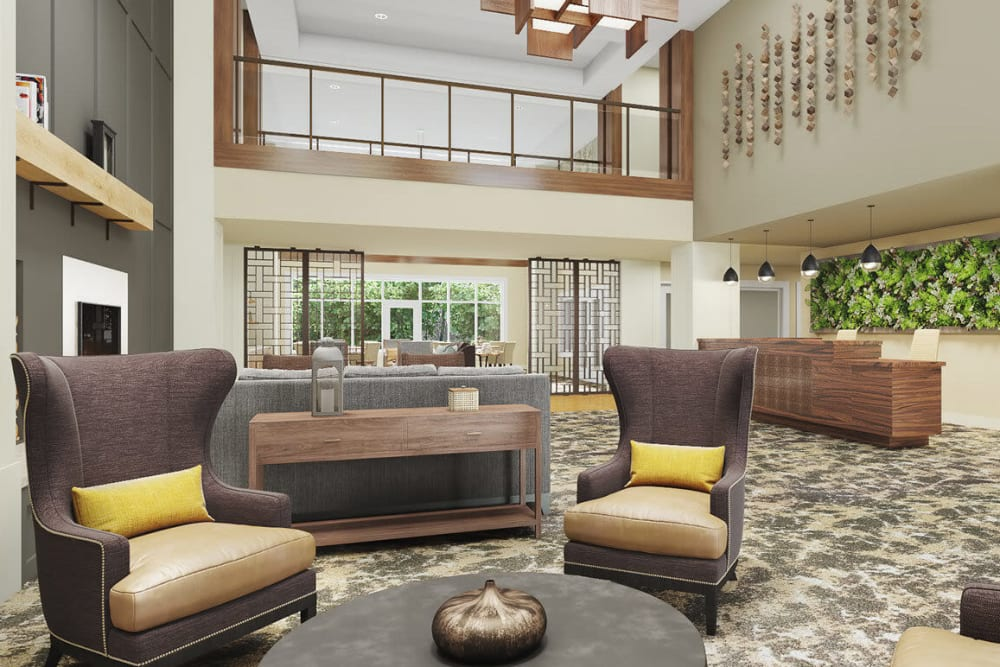 Bright lit and modern lounge complete with comfy arm chairs and wood accents in upscale senior living facility at The Springs at Sherwood in Sherwood, Oregon