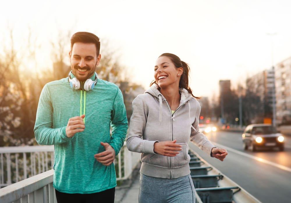 Resident couple running through San Jose, California nearby Sofi Riverview Park
