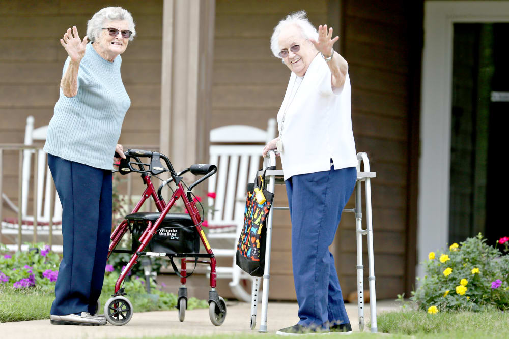 Two residents waving hello at Providence Assisted Living in Clarksville, Arkansas.