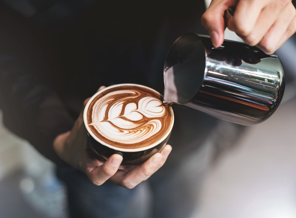 Barista making a latté for a customer near Sofi Gaslight Commons in South Orange, New Jersey