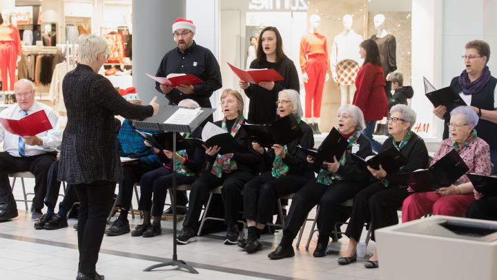 Image of Touchmark residents in their choir singing at Kirkwood Mall in Bismarck, North Dakota.