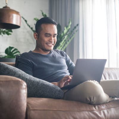 Resident working from home in his cozy living room at Haven Apartment Homes in Kent, Washington