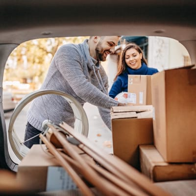 Couple unloading boxes from their car at A-American Self Storage in Palmdale, California