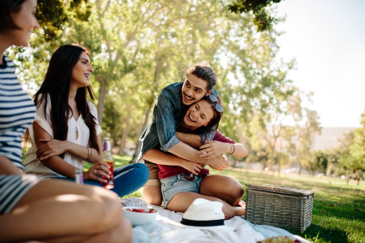 Friends enjoying a picnic in Lexington, South Carolina near Lullwater at Saluda Pointe
