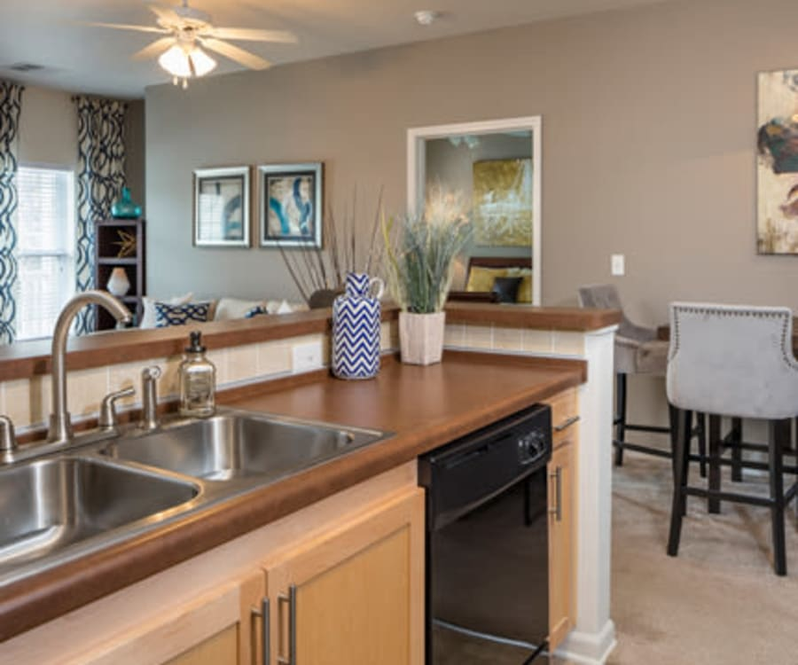 Model home's living area with hardwood floors and modern furnishings at The Fairways Apartment Homes in Lee's Summit, Missouri