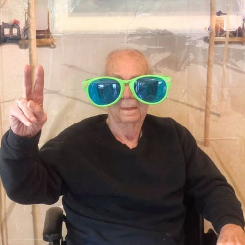 Resident peace sign at Oxford Glen Memory Care at Sachse in Sachse, Texas
