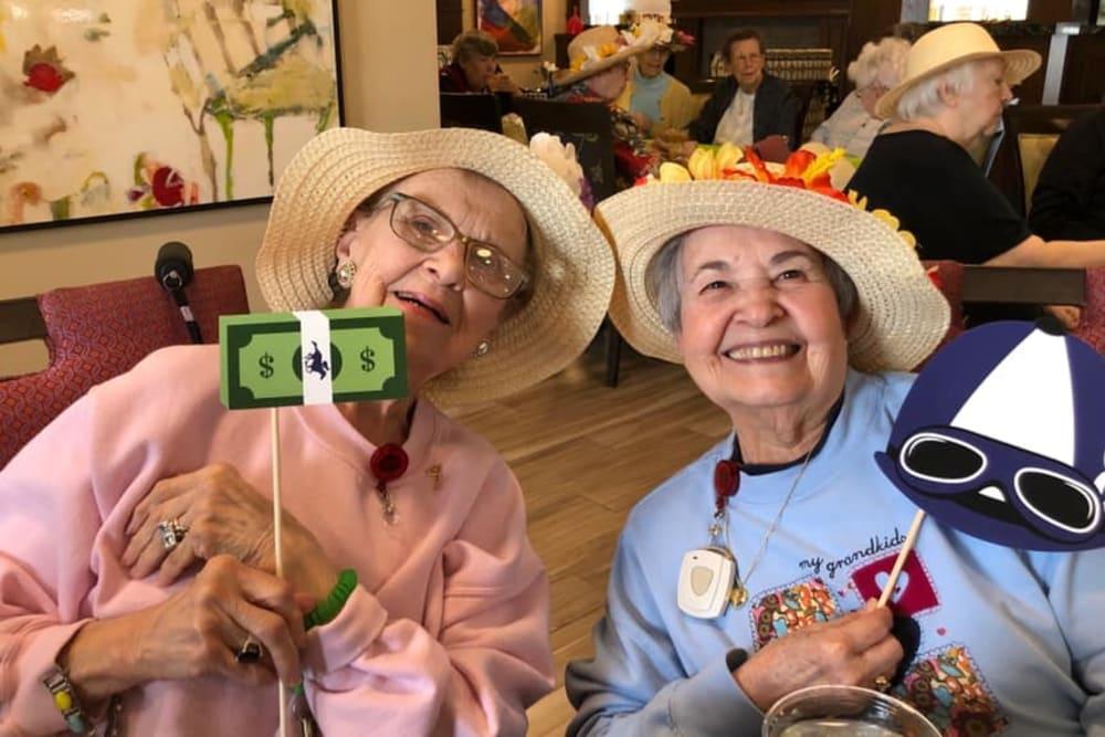 two senior residents smiling