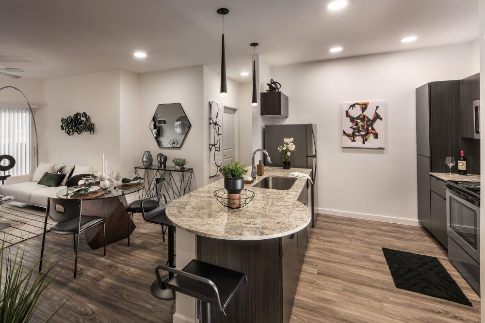 Beautiful open-concept floor plan with hardwood floors in model home at Villa Vita Apartments in Peoria, Arizona