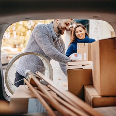 Couple unloading boxes from their car at Sierra Vista Mini Storage in Bakersfield, California