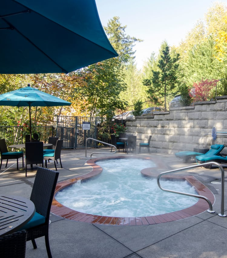 Steaming spa on a crisp morning at Sofi at Forest Heights in Portland, Oregon