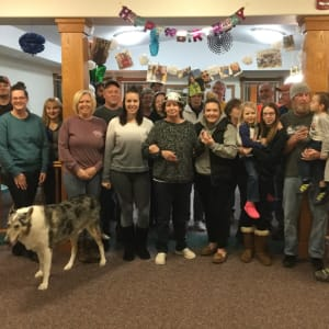 Resident Luann's family celebrating her birthday party at Prairie Hills in Tipton, Iowa.