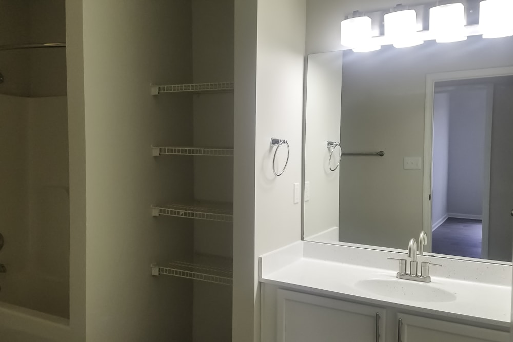 Bathroom with built-in shelving at Cooper Creek in Louisville, Kentucky