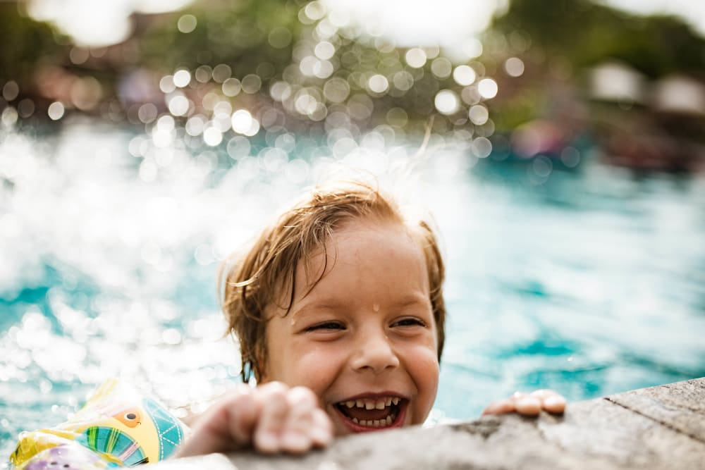 Resident child swimming in the pool at Cortland Village Apartment Homes in Hillsboro, Oregon