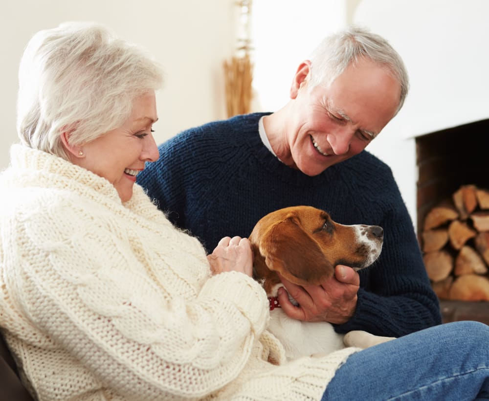 Two residents of Touchmark at Meadow Lake Village in Meridian, Idaho at home with their dog