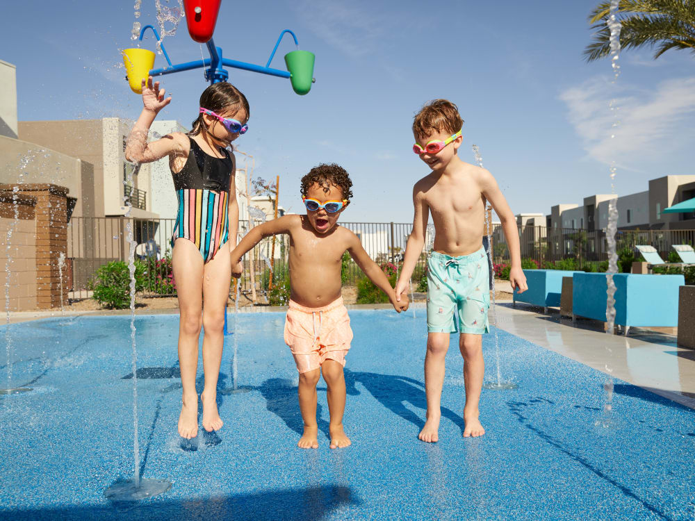 Residents playing in the pool at BB Living at Higley Park in Gilbert, Arizona
