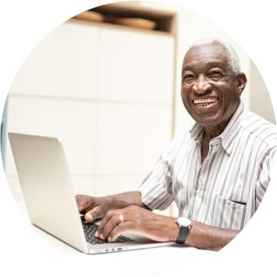 Resident doing an online class on a laptop at Hanover Place in Tinley Park, Illinois