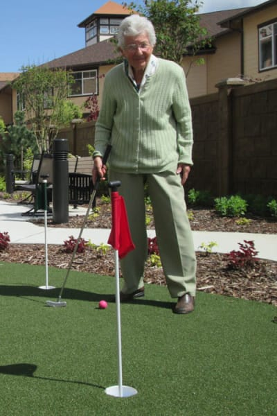 Senior man playing golf at Quail Park at Browns Point in Tacoma, Washington