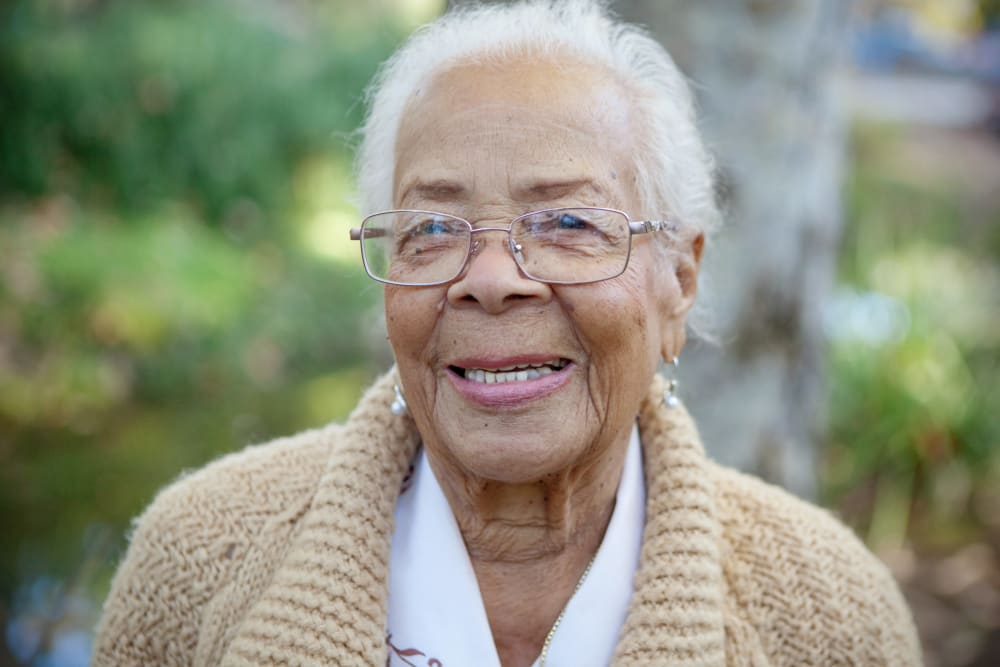 senior woman smiling at camera at Symphony at Cherry Hill in Cherry Hill, New Jersey