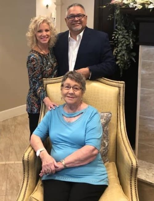 A female resident and her family at Inspired Living at Bonita Springs in Bonita Springs, Florida.