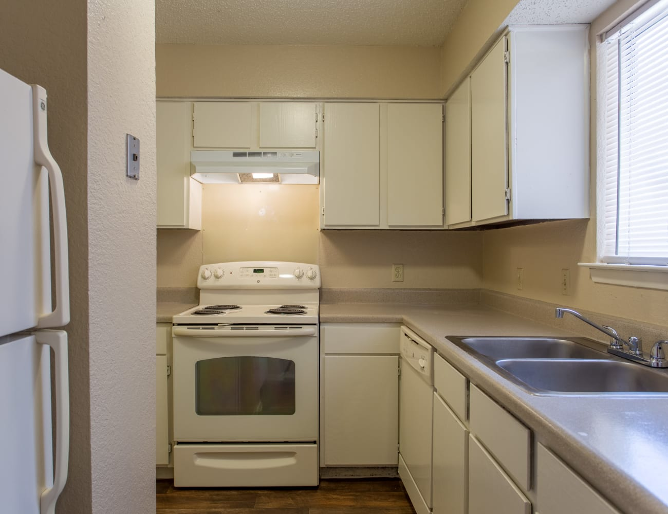 Spacious kitchen with hardwood floors at Canopy on Central in Bedford, Texas