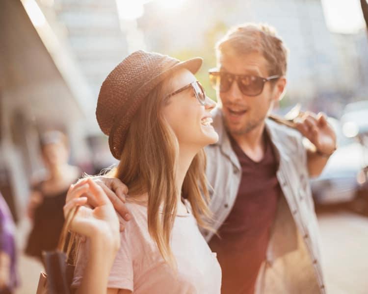 Young couple having fun in city area near Augusta Meadows