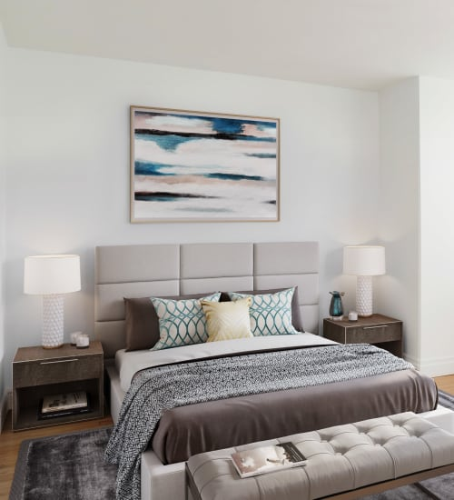 A modern bedroom with white walls at The Metropolis in New York, New York