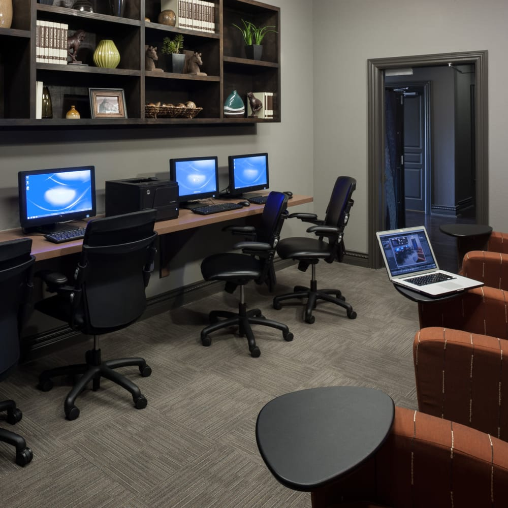 Community business center with complimentary desk top computers at The Asten at Ribelin Ranch in Austin, Texas