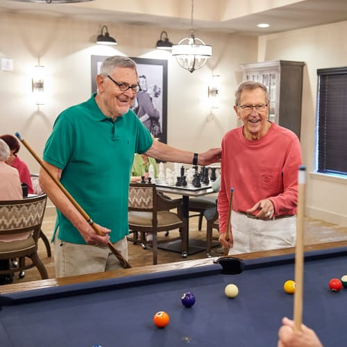 Residents gathered around a pool table at The Crossings at Eastchase in Montgomery, Alabama
