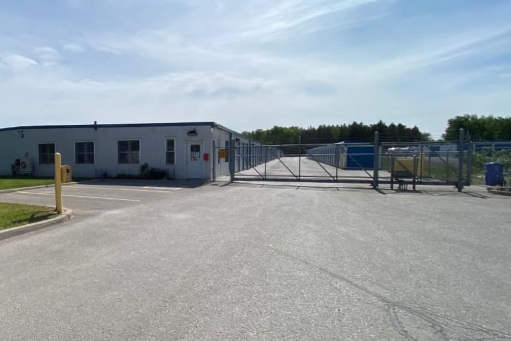 Main entrance with electronic gate access at Vault Self Storage in Holland Landing, Ontario
