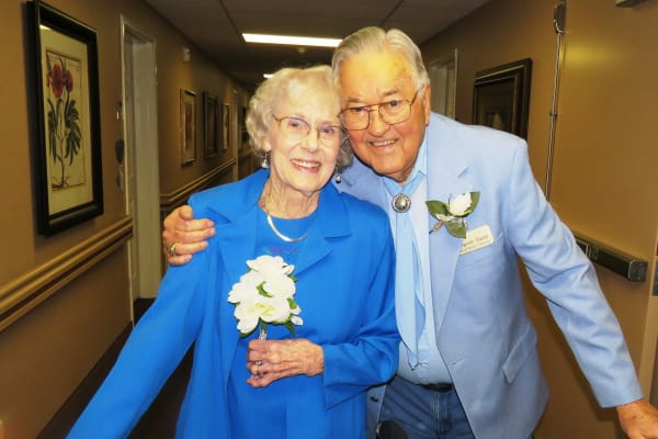 Elderly couple posing for a photo at Ashton Gardens Gracious Retirement Living in Portland, Maine
