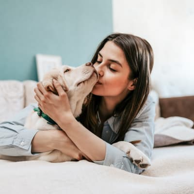 Resident and dog in a pet-friendly community of Haven Residential