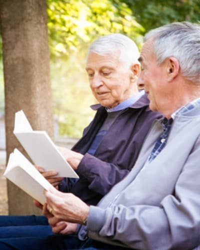 Residents reading in the park at Keystone Villa at Douglassville in Douglassville, Pennsylvania