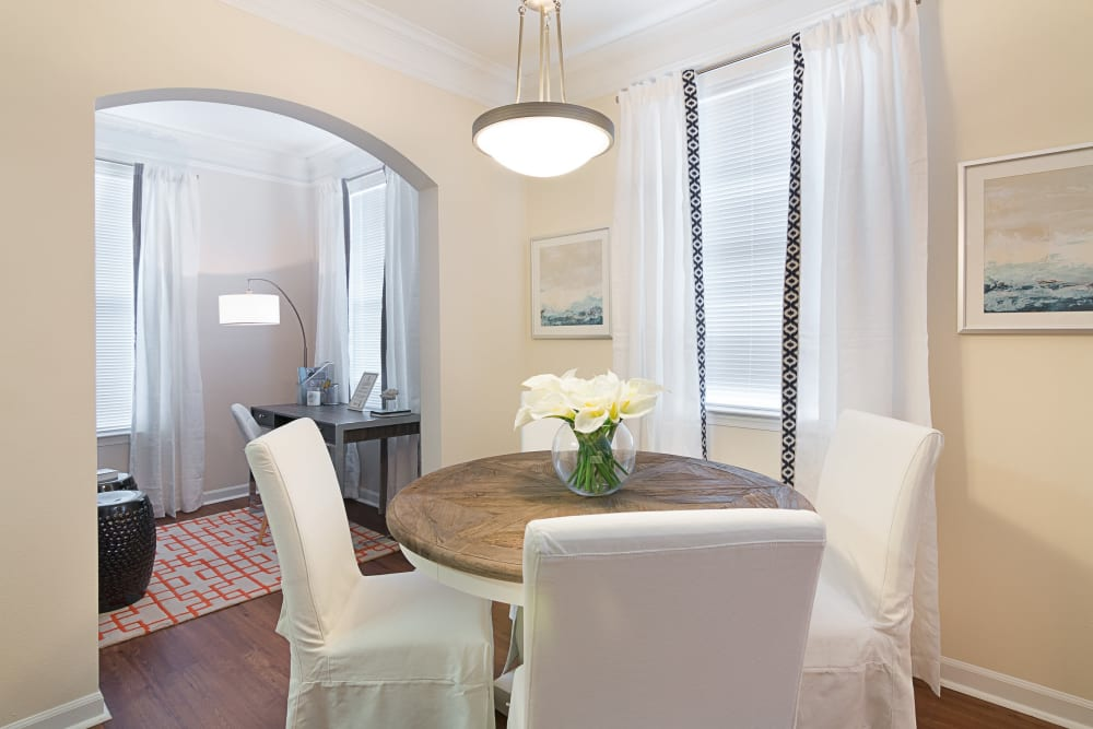 Dining room table and office desk in model apartment at Landings at Four Corners in Davenport, Florida