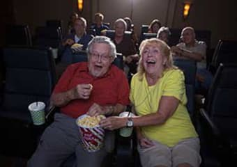 Residents at the movies at Discovery Village At Boynton Beach in Boynton Beach, Florida