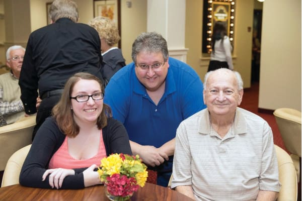 Resident with his son and daughter at Ashton Gardens Gracious Retirement Living in Portland, Maine