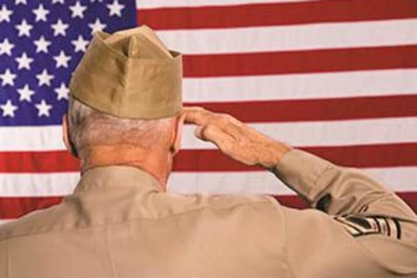 Veteran salutes flag proudly at Caruth Haven Court