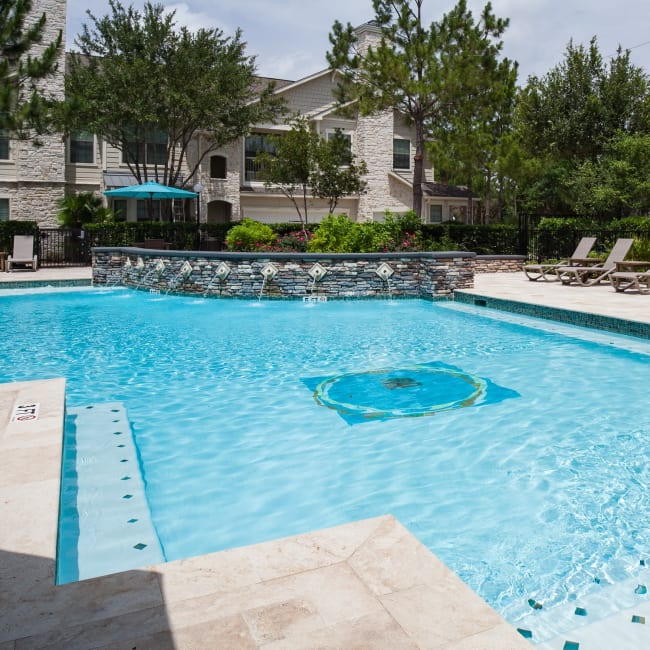 Swimming pool with a water fountain at Lakefront Villas in Houston, Texas