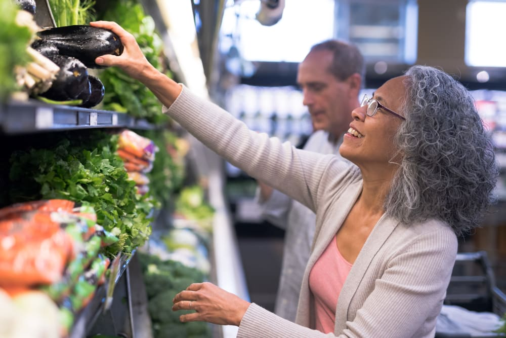 Resident shopping for produce in San Jose, California near Brookdale Apartments