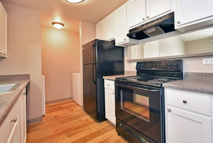 Kitchen with hardwood floors at Maybeck at the Bend