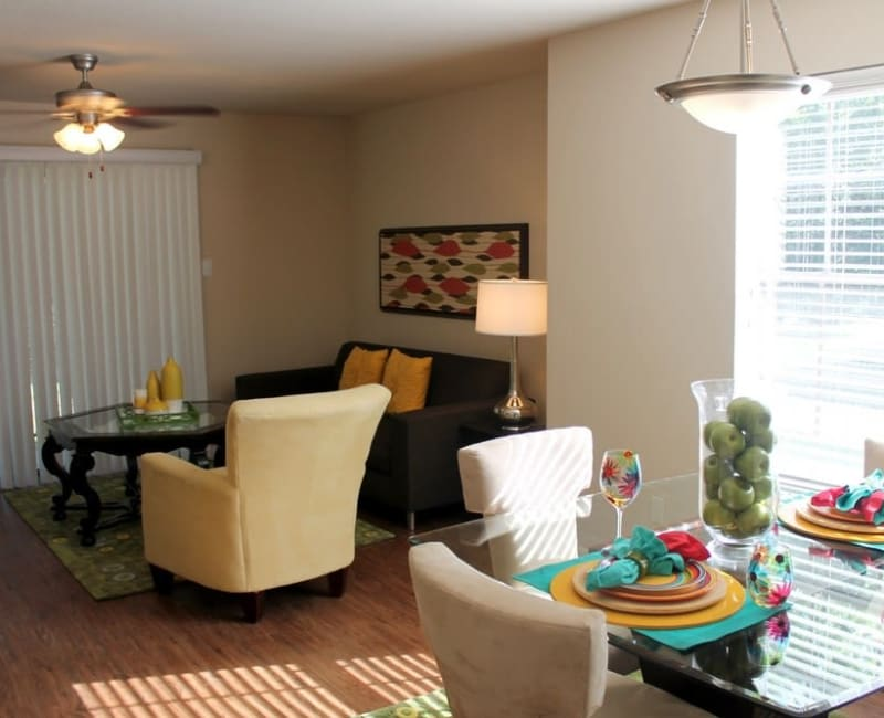 Spacious living room with lots of windows for natural lighting at The Reserve at Windmill Lakes in Houston, Texas