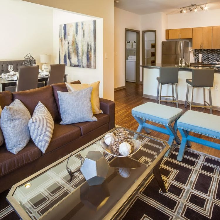 Well-decorated living area with hardwood floors in model home at Presley Oaks in Charlotte, North Carolina