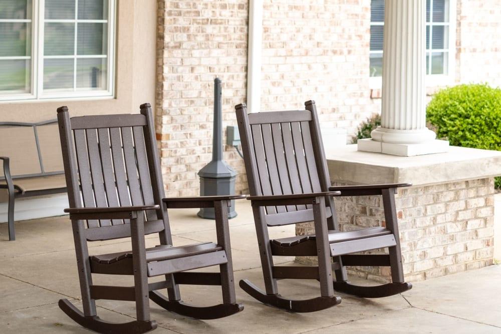 Charming rocking chairs on a porch at Brookstone Estates of Vandalia in Vandalia, Illinois