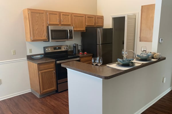 An apartment living room and kitchen at The Landings Apartments in Clifton Park, New York