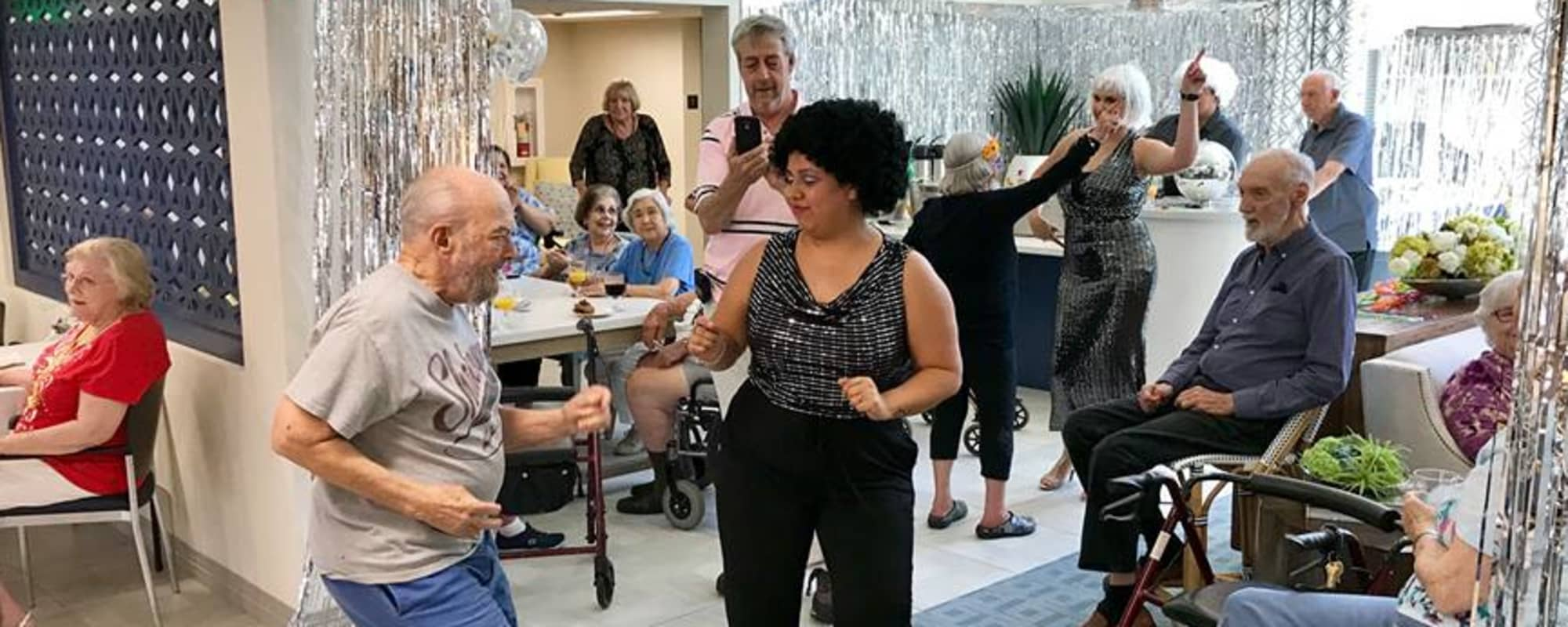 Residents celebrate and dance together at Fairview Commons